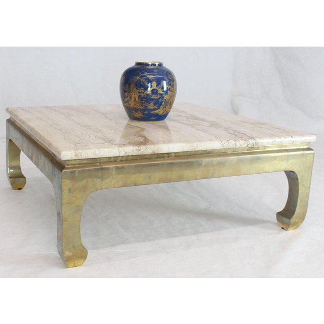 Mid-century modern brass and travertine square coffee cocktail table. Made in the 1970s.