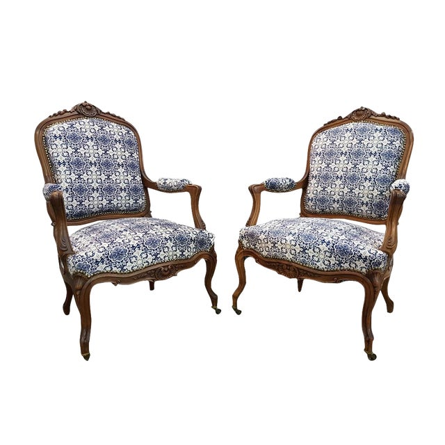 Gorgeous Pair of French Newly Upholstered Carved Walnut Louis XV Caster Wheel Armchairs For Sale