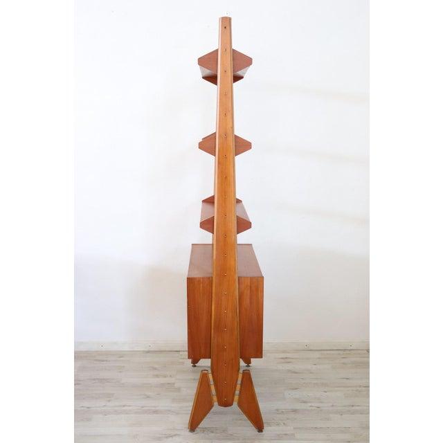 Delicious 20th century Italian vintage design bookcase. Bookcase dated around 1970s Italian cherry design. Line of design...