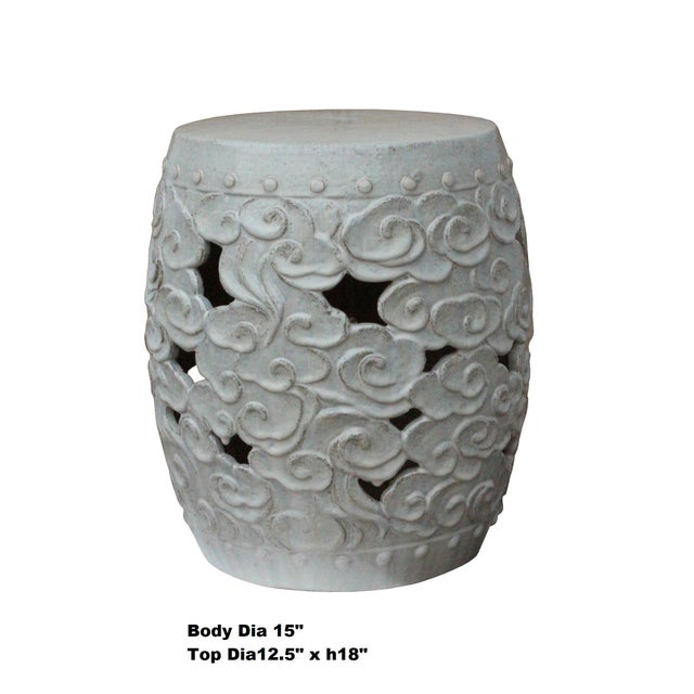 This is a handmade Chinese accent decorative garden clay stool in a round shape with scroll cloud pattern. The surface is...