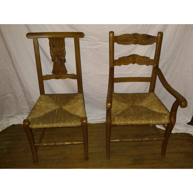 """Set of four vintage French Country hand carved rush seat arm and side chairs. Arm Chair: 38.5""""Hx18""""Dx22""""W / Arm height 26""""..."""