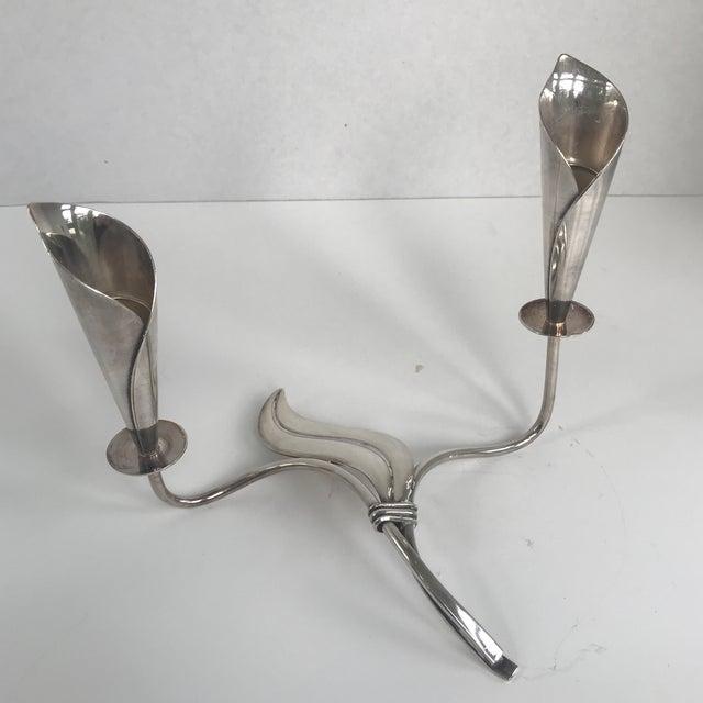 Unique vintage silver leaf form candle stick holder. Marked Denmark. Bears the makers mark (fish) for Hand Jensen, a...