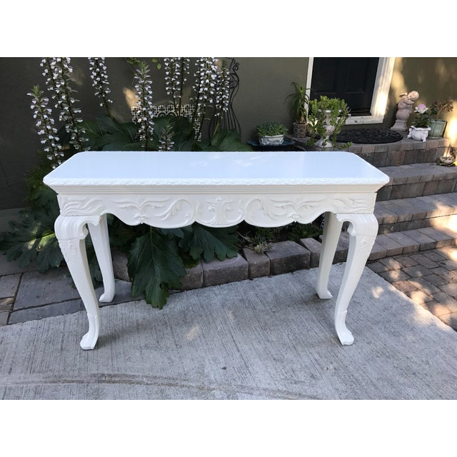 "Gorgeous all wood ornate French hall/sofa/accent table. Freshly painted. It has beautiful ornate detail. 34.5"" tall x 56""..."