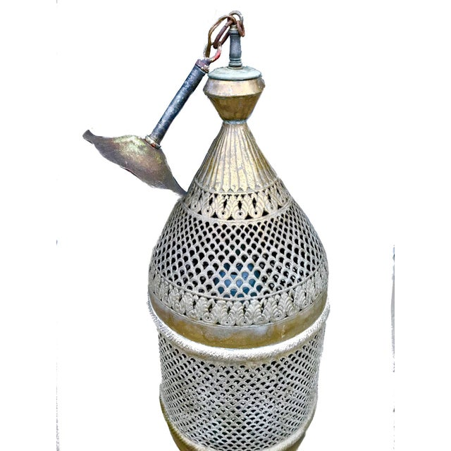 A fantastic, vintage, Moroccan style pendant light made from solid brass. The brass has gorgeous patina, and is pierced in...