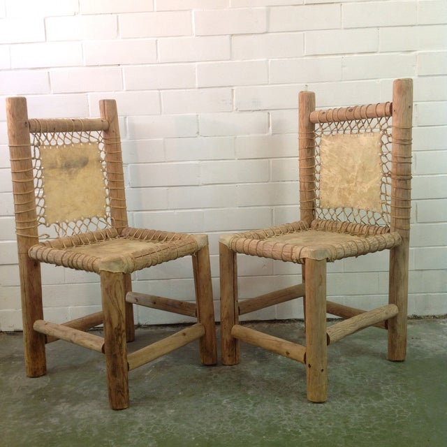 Vintage hand made Lodgepole and hide chairs. Very rustic, good age. We ALWAYS accept reasonable offers. Before it's gone...