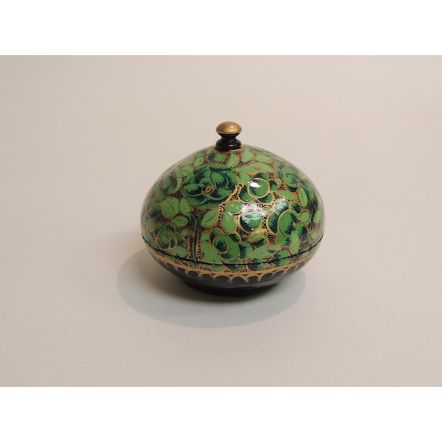 Small Vintage Hand Painted Indian Lacquered Box. Round small box painted with green flowers and leaves and accent in gold....