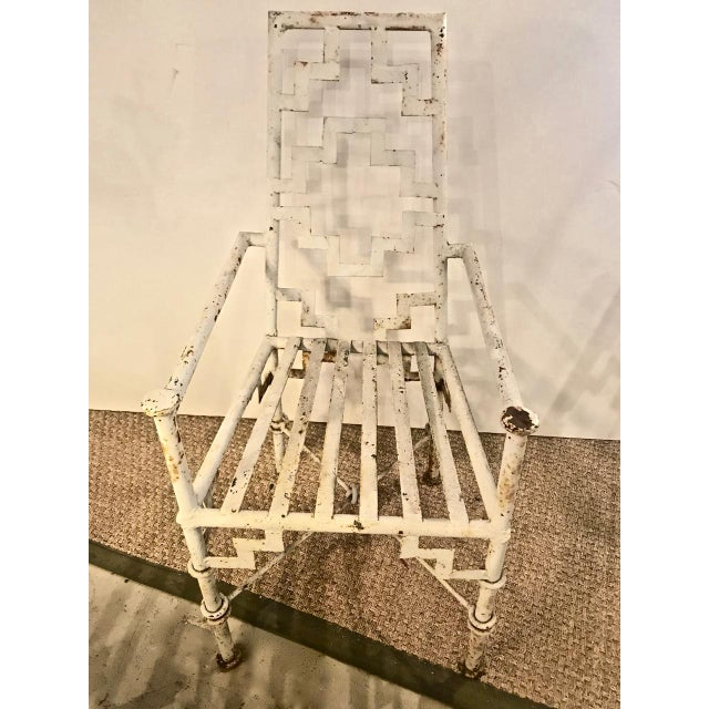 This is superb pair of Art Deco period chinoiserie iron patio chairs that date to the 1930s. The chairs retain their...