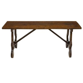Early 20th Century Spanish Baroque Walnut Trestle Bench For Sale