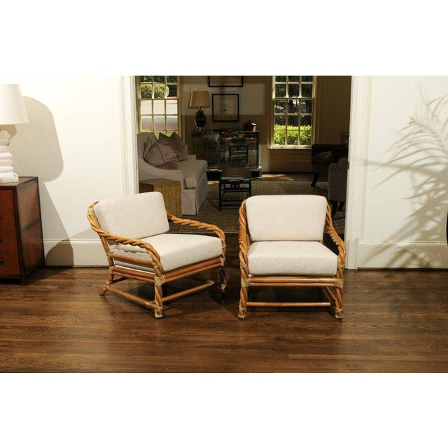 A beautiful pair of loungers from a difficult to find series by McGuire, circa 1980. Clever braided rattan design with...