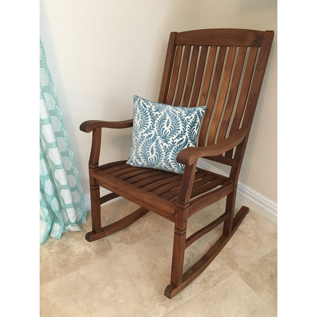 Solid Teak Cambridge-style rocking chair. Carefully hand crafted and coated with a medium-brown weather-resistant polish....