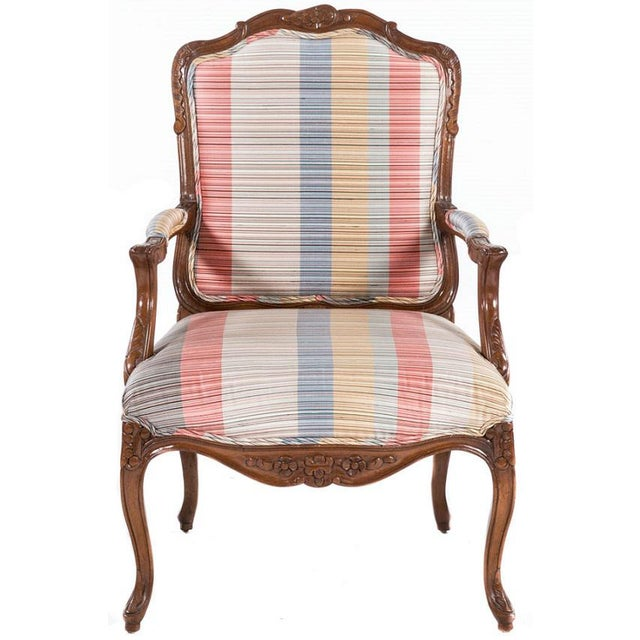 """Pair French Carved Open Armchairs. Hand carved walnut frames with contemporary plaid fabric seat height 18""""."""
