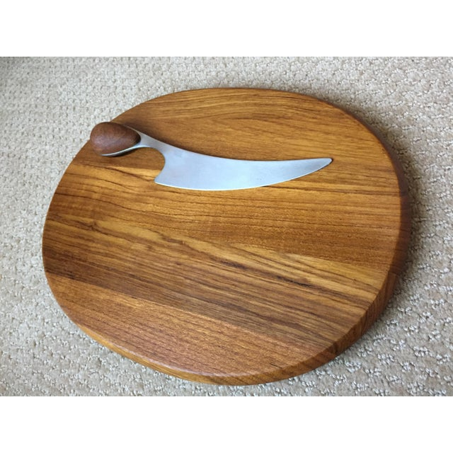 Gorgeous oval teak cheeseboard with knife designed by master jeweler and silversmith Vivianna Torun Bulow-Hube for Dansk....