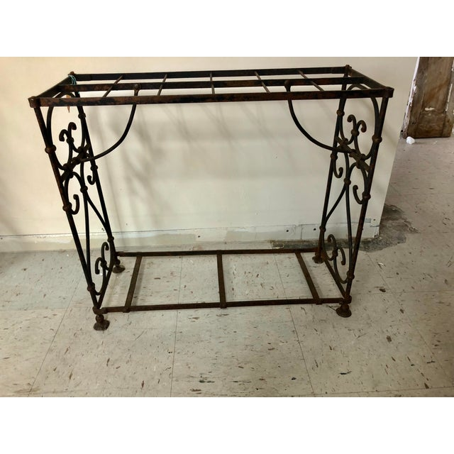 Unusual iron umbrella/stick stand. A nice piece twitch multiple uses. Made in the 1900s.