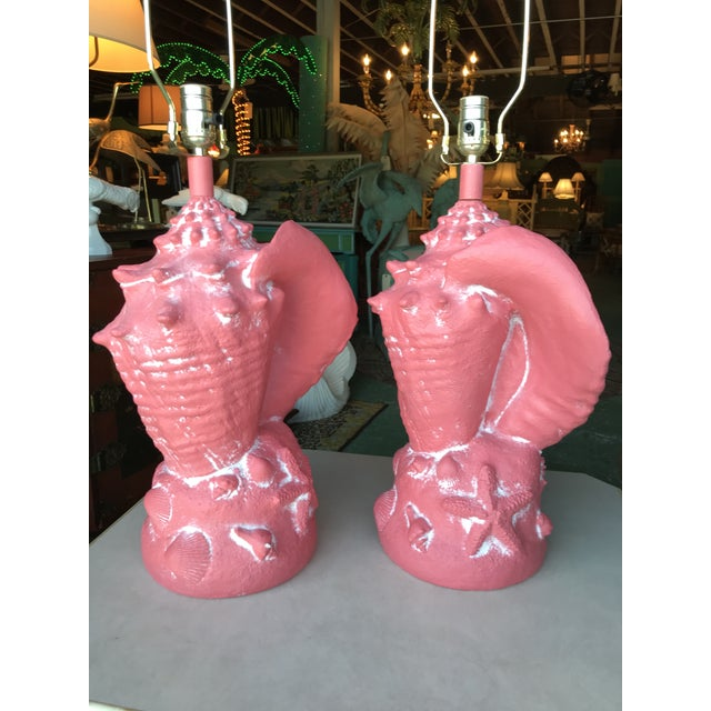 Fun large coastal conch shell lamps in a beautiful coral color. One small nick on one of the shells up front along with...