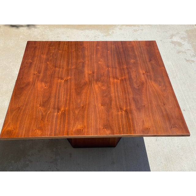 Mid-century Danish modern 40 x 40 x 16 walnut coffee table on an octagonal base. The beautifully refinished top is rich in...