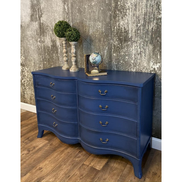 If you are looking for a Modern spin on a solid wood, 1940s dresser this dresser is for you! This bow front MCM dresser is...
