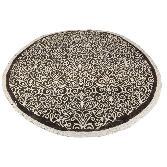 """""""An elegant hand knotted round rug made of finest quality wool and viscous is a brilliant foundation for any room...."""