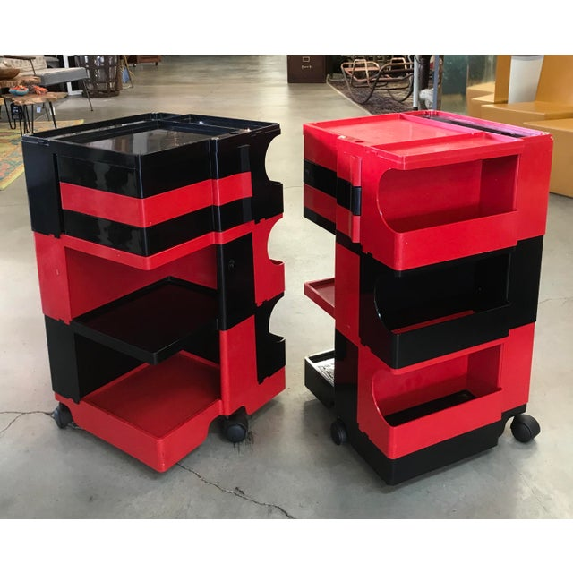 Amazing pair of original vintage Boby Trolleys designed by Joe Colombo. Two tone red and black ABS plastic. These are in...