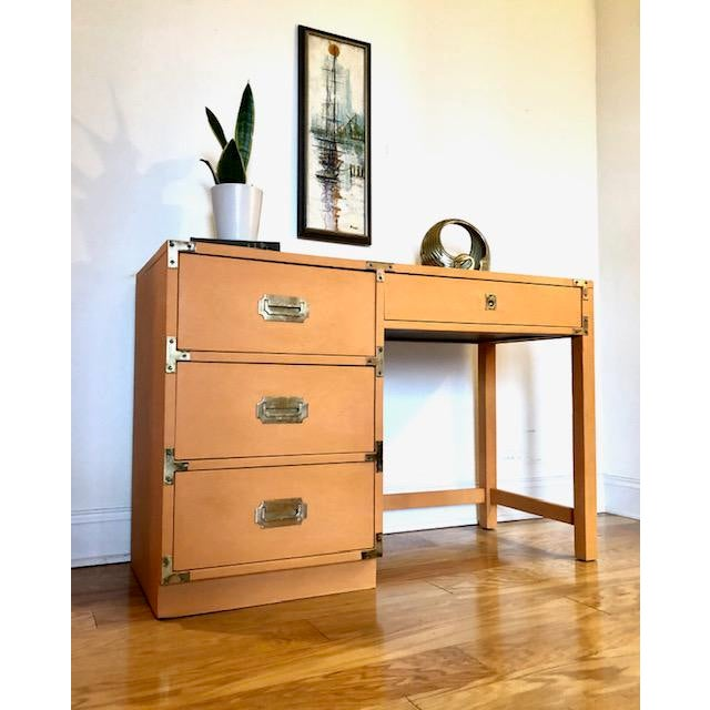 Just available is this beautiful campaign desk in orange by Bernhardt that was made in the 1960's. It has been hand...