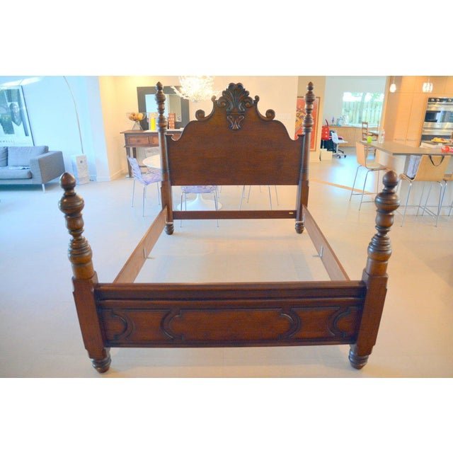 Really a beautiful piece, dark stained wood is gorgeous, deep rich brown. We purchased this carved wood Ralph Lauren bed...