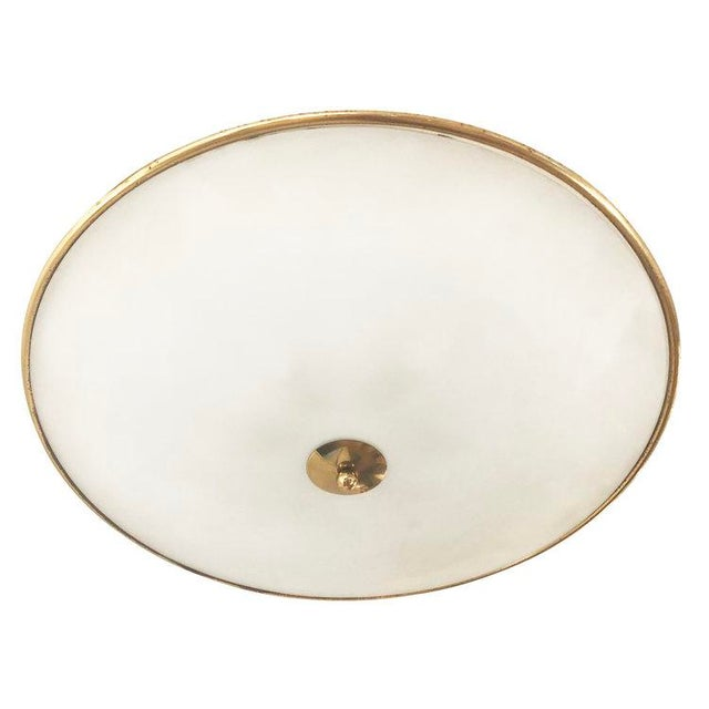 Circular glass and brass flush mount fixture attributed to Pietro Chiesa for Fontana Arte. Simple and elegant.