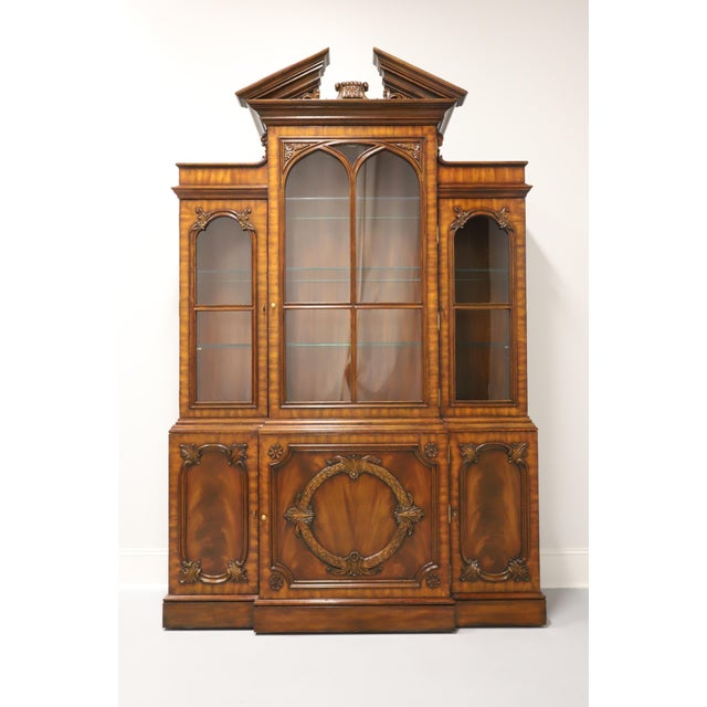 A Chippendale style china cabinet by Maitland Smith. Made in the Philippines in the late 20th Century. Aged mahogany and...