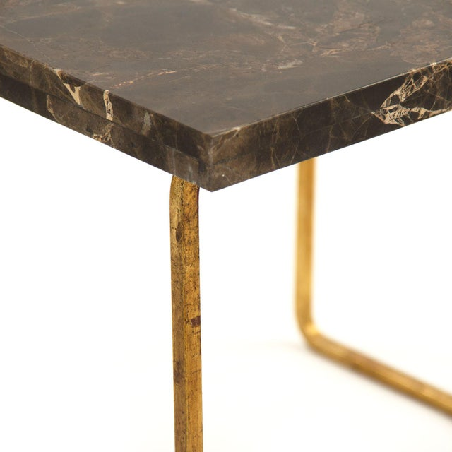 Set of two rectangular top end tables with brown marble top and gold leaf base.