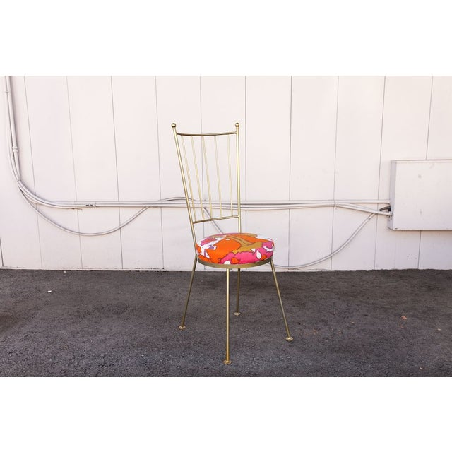 An adorable John Salterini style iron chair, powder coated in gold with a colorful vintage Peter Max fabric. John B....