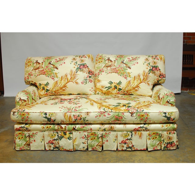 Fabulous custom sofa upholstered in Brunschwig & Fils Les Perdrix Chintz toile fabric featuring wheat sheaf, flowers, and...