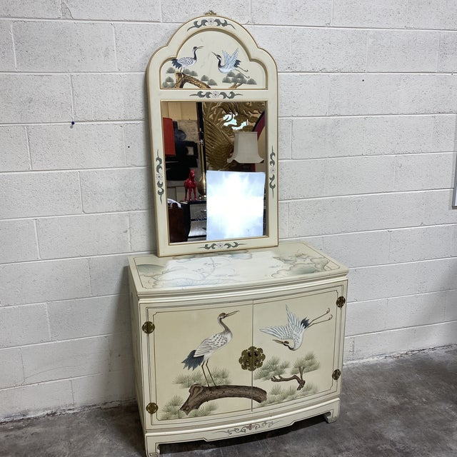 Great Asian style hand painted chest with brass accents and complimenting mirror. Mirror measures 24x43x1. Scene is birds...