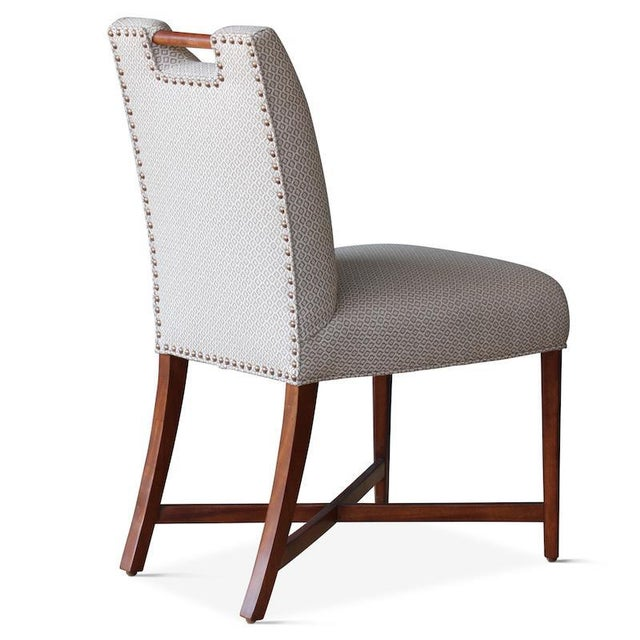 The Condesa dining chair has beautiful lines, a chic nailhead detail along the back, and a built-in handle for easy...