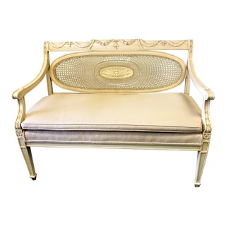 Vintage French Carved Wood Settee With Cane and Oval Back Detail For Sale