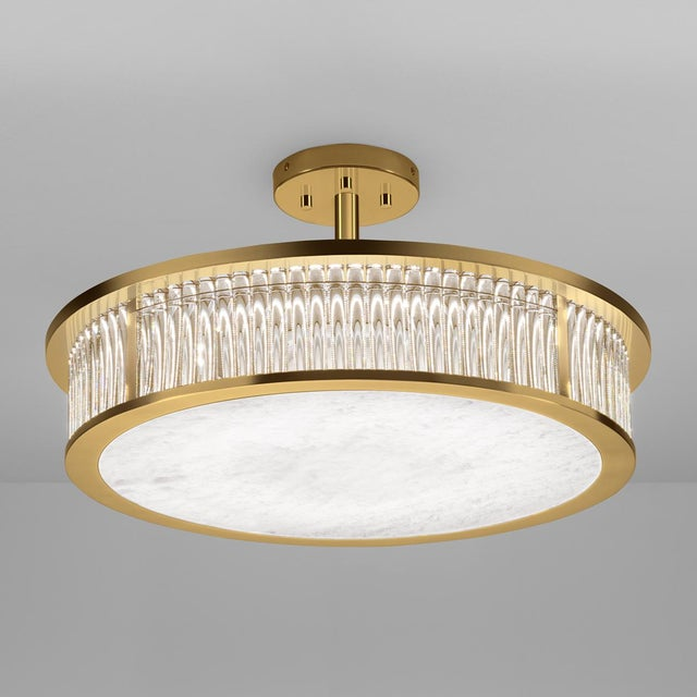 Polished brass ceiling light with dimmable integral light source that sparkles and reflects through individual solid clear...