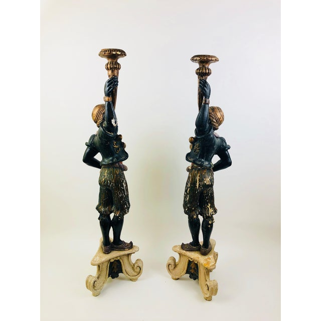 This pair of Blackamoors came from an estate in San Francisco and retain their original colors without retouching. The...