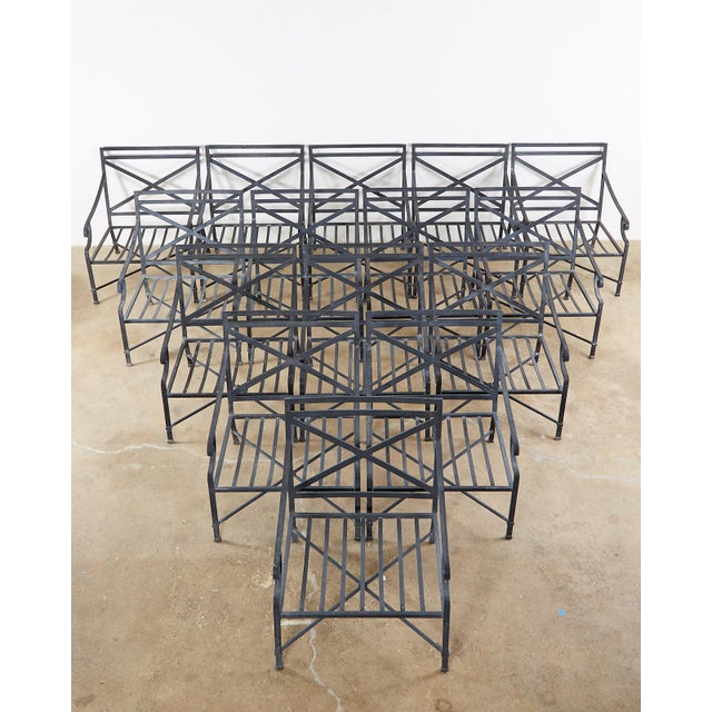 Large collection of ten aluminum patio and garden lounge chairs made by Brown Jordan. All armchairs made of wrought...
