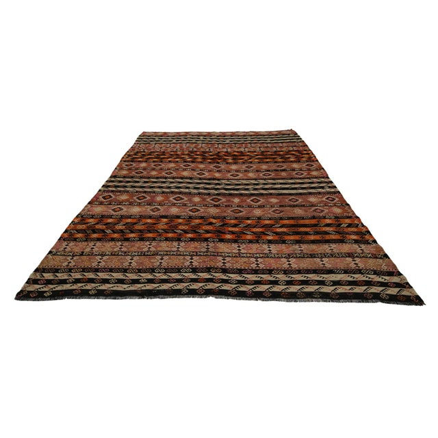 Handwoven vintage kilim rug from Afyon region of Turkey. Approximately 50-60 years old. In very good condition.