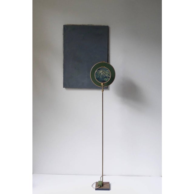 Light object, floor lamp, circle blue grey Handmade in brass, leather, wood and hand printed and painted linen. A dimmer...