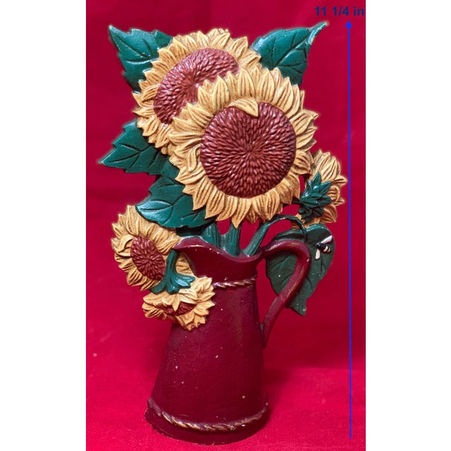 Vintage hand painted cast iron door stop with a pitcher filled with sunflowers. Perfect for a cottage style home.