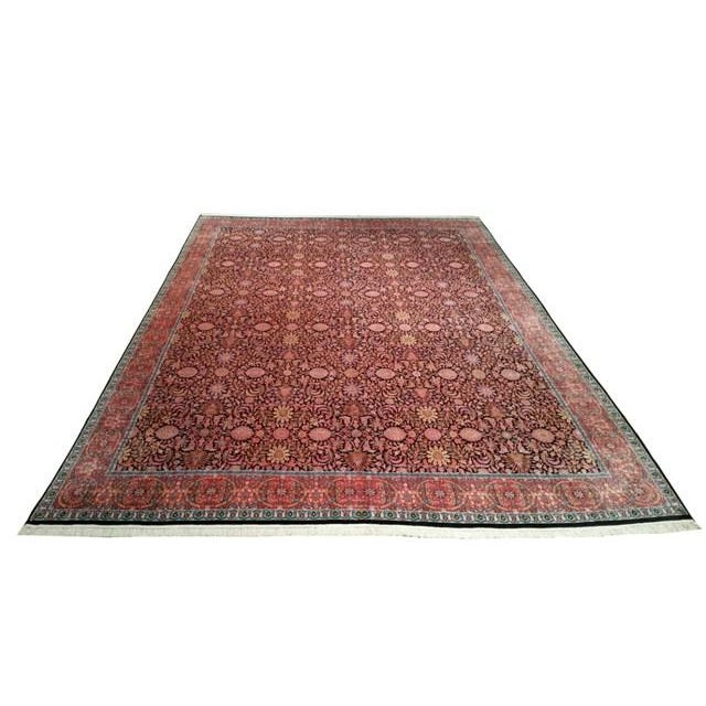 Infuse a touch of beauty to high-traffic areas of your home with this durable Kashmir rug in colors of black, pink, blue....