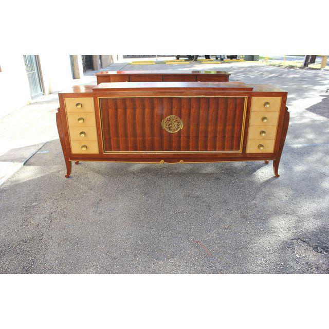 Spectacular grand designer sideboard made of exotic palisander or rosewood on saber legs, featuring two doors and eight...