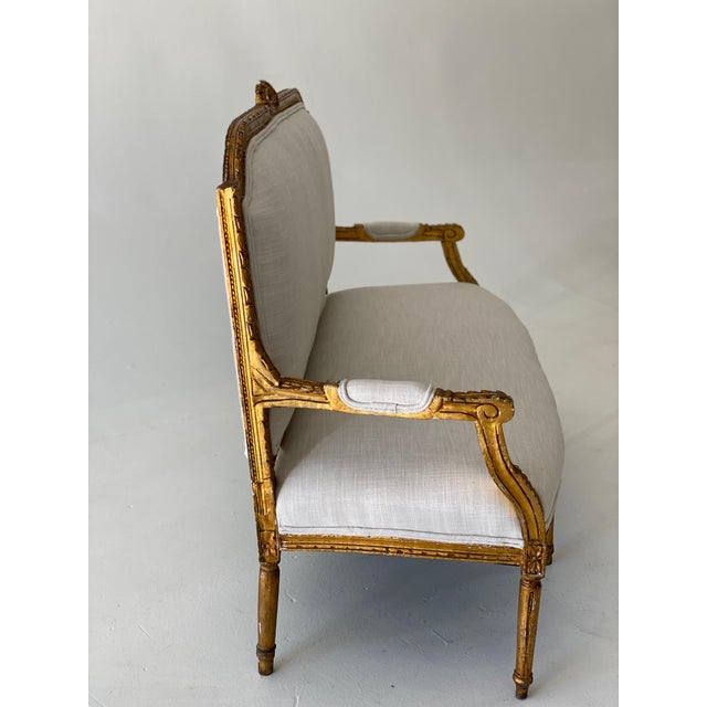 """Gilt Wood French Louis XVI Style Settee with original 19th c. gilt and new Crypton fabric with self-piping. seat Height 18""""."""