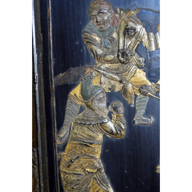 Asian Early 20th Century Chinese Lacquered Armoire With Gilt Carved Warrior Motifs For Sale - Image 3 of 13