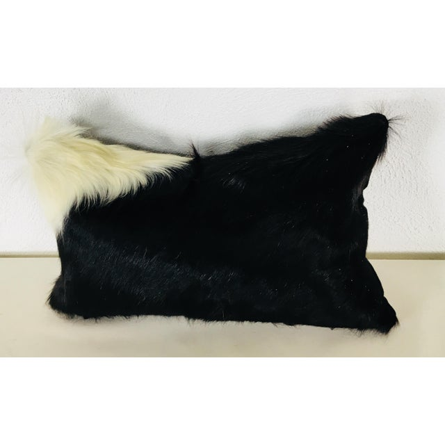 This is a natural cowhide pillow with a cotton velvet reverse. Pillows are made in house and include a goose feather and...
