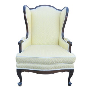 French Upholstered Mahogany Wing Chair For Sale