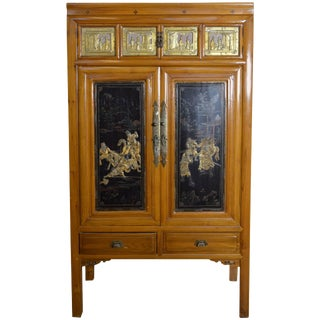 Early 20th Century Chinese Lacquered Armoire With Gilt Carved Warrior Motifs For Sale