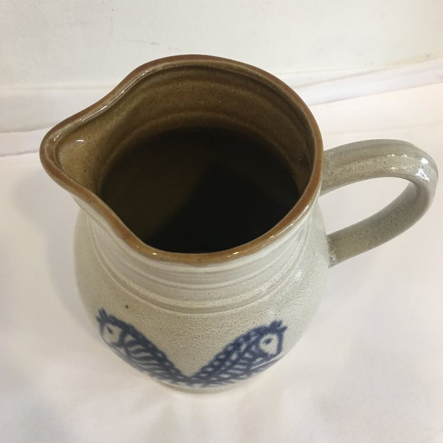 Really cute folk art stoneware pitcher with blue zebra horses. Horses are navy blue with cute faces and wagging tails.