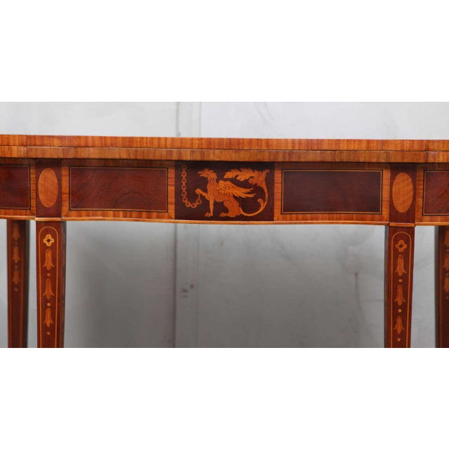 This inlaid mahogany game table has some great examples of federal style motifs and techniques including a griffin inlaid...