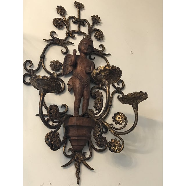 Iron S scrolled sconce, with full figure carved walnut wood cherub with wings. Very unique!! Great vintage piece! Honey...