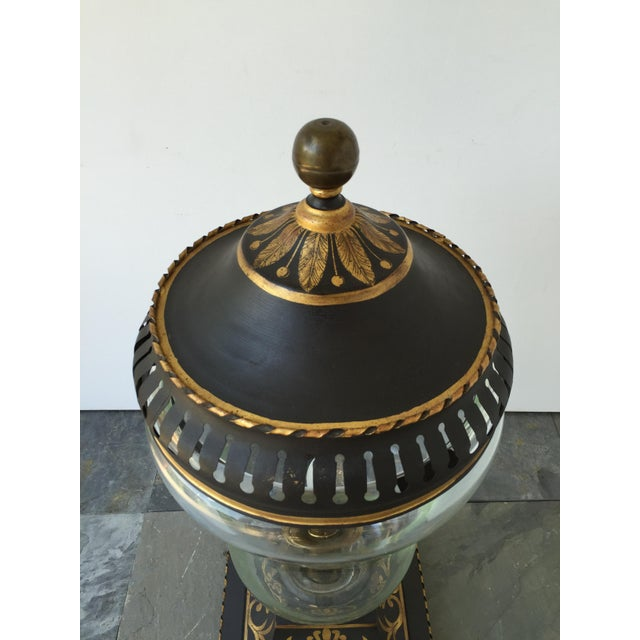 20th c. Continental green gilt tole peinte and glass decorative table lantern with brass spherical finial and single...