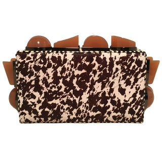 Tonya Hawkes Brown and White Cow Print Pony Hair Clutch With Tan Acrylic Studs For Sale